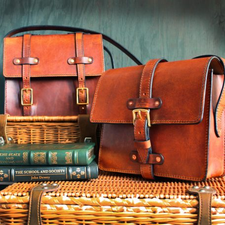 Hand stitched leather satchels with brass and copper hardware